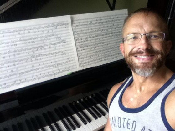 "Working on the ""Velocity"" etude at the piano a few weeks ago.  It was still HOT in Boston...  I'm a little sweaty."